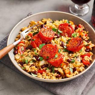 Paella met gebakken tomaten